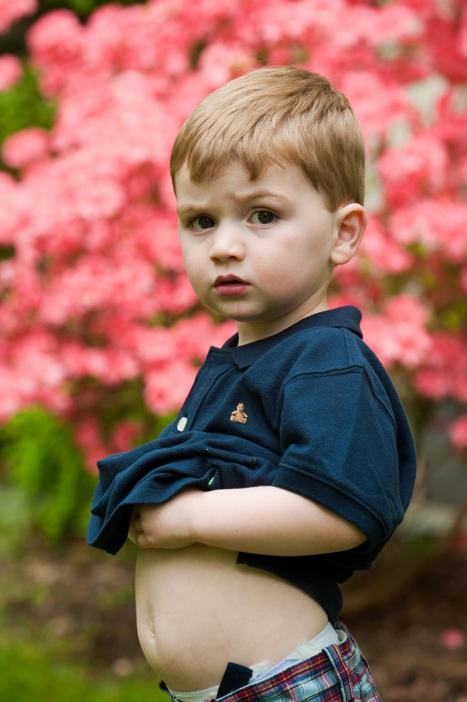 young boy sticking out tummy