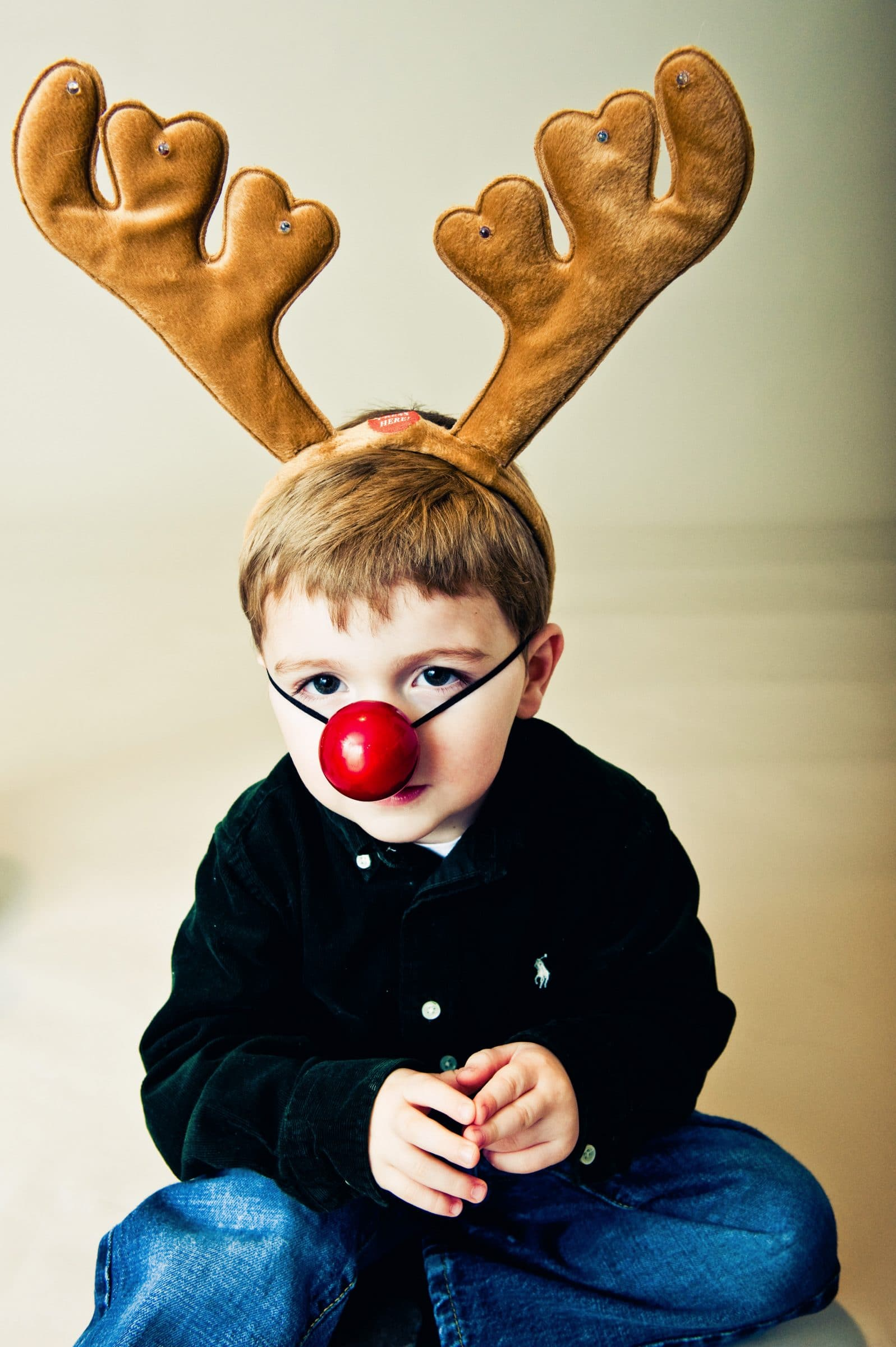 boy dressed as a reindeer for christmas