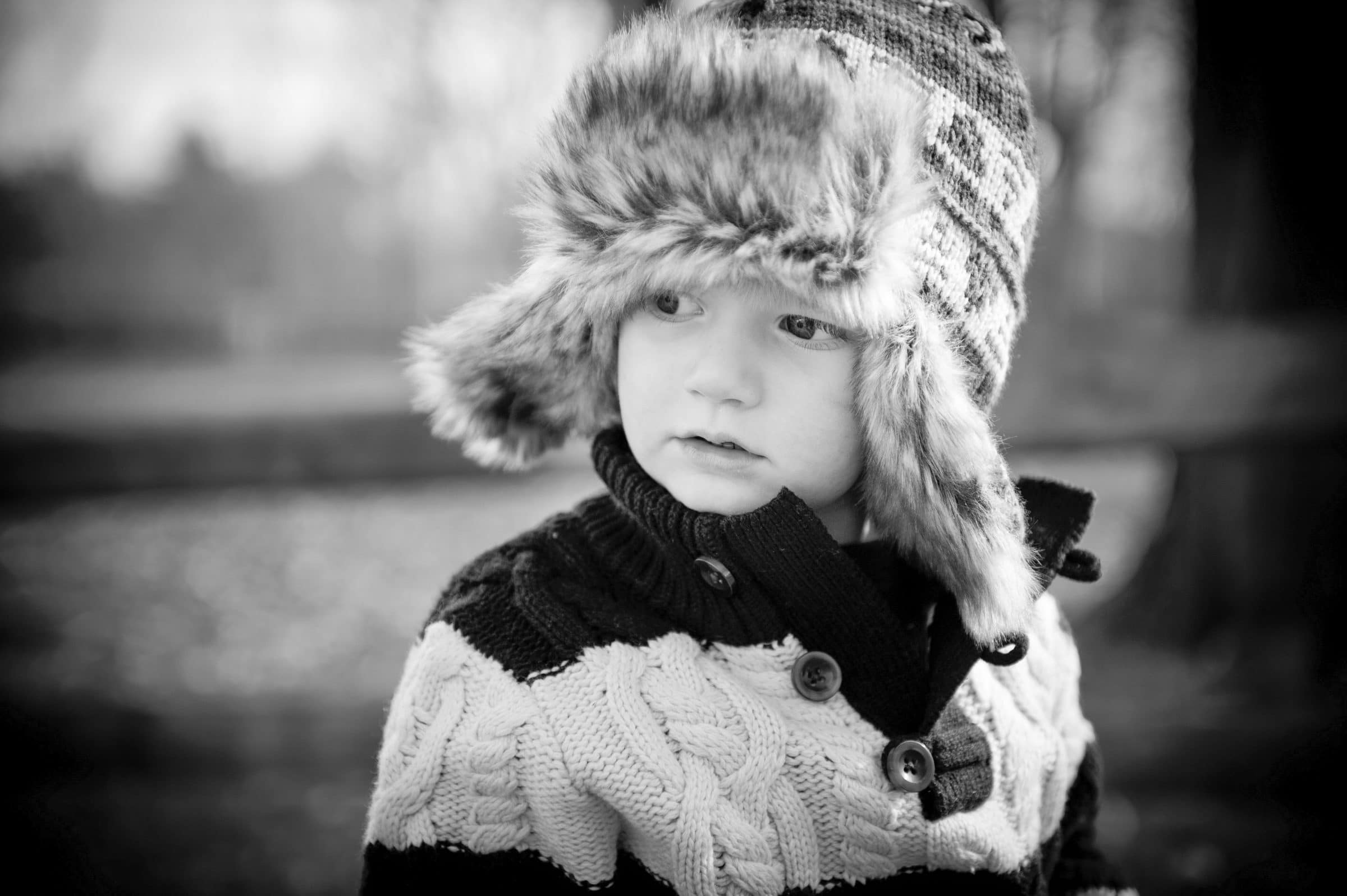 young boy in furry winter hat
