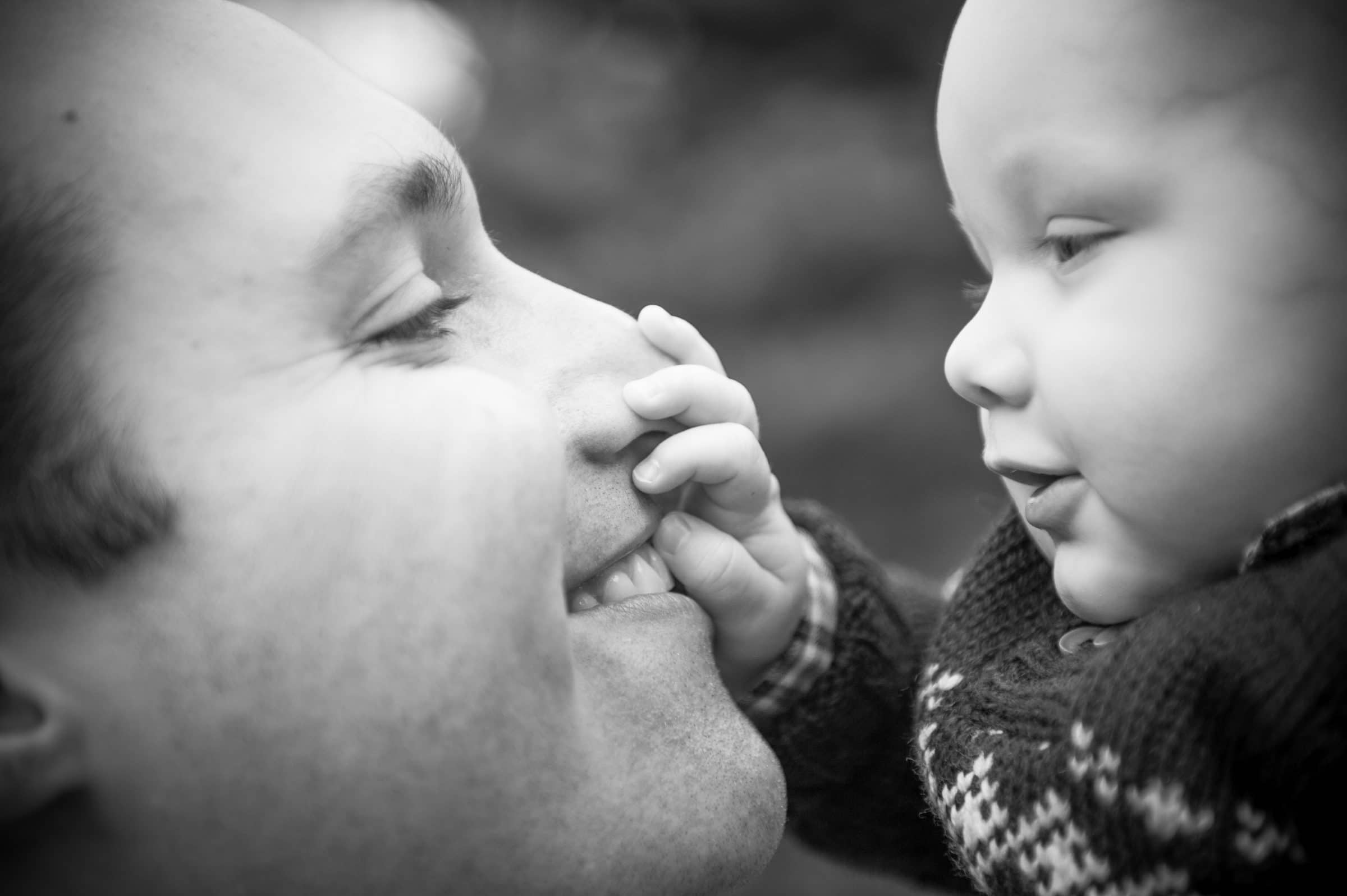 son grabbing dads nose