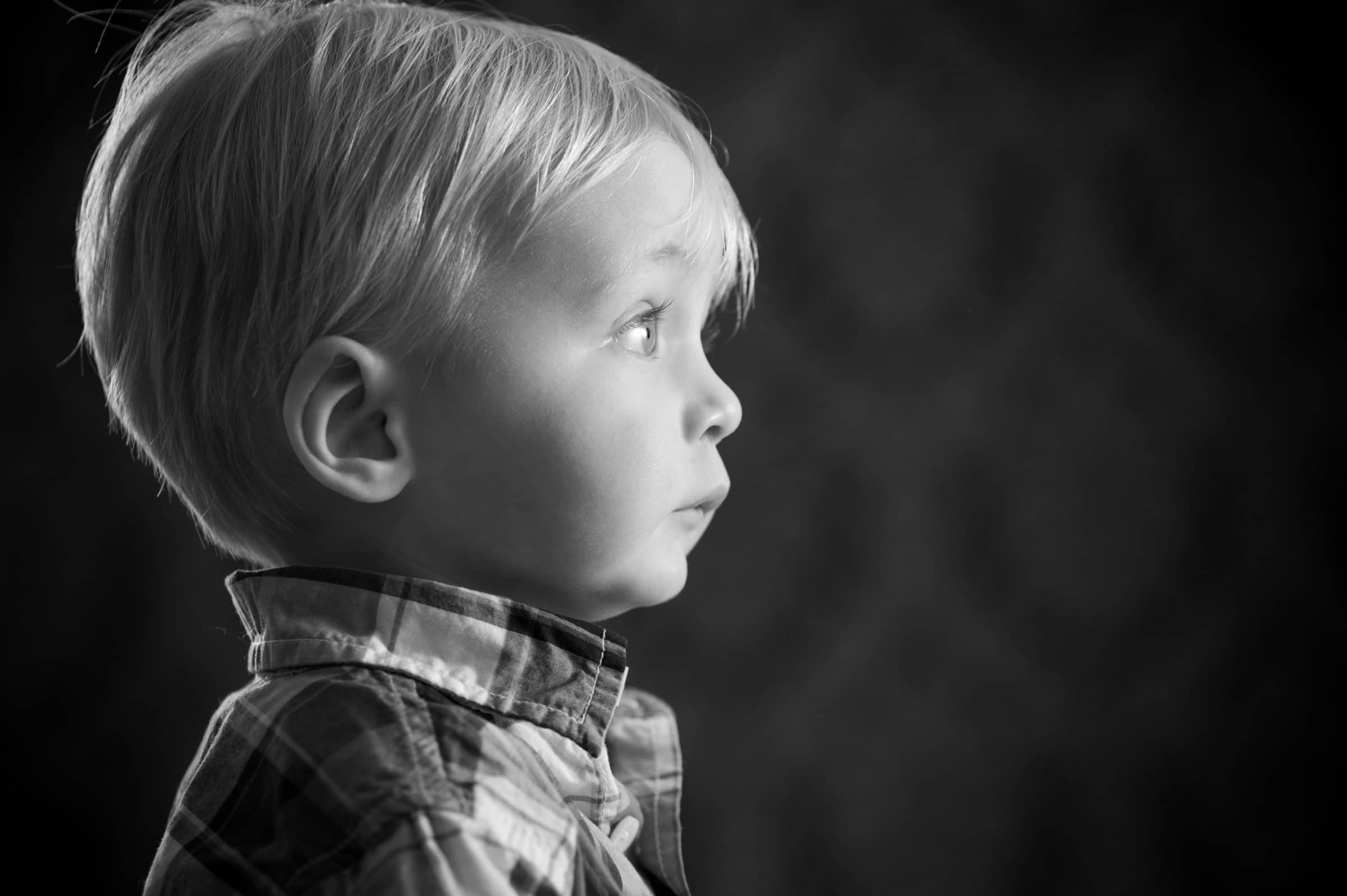 profile of young boy in B&W