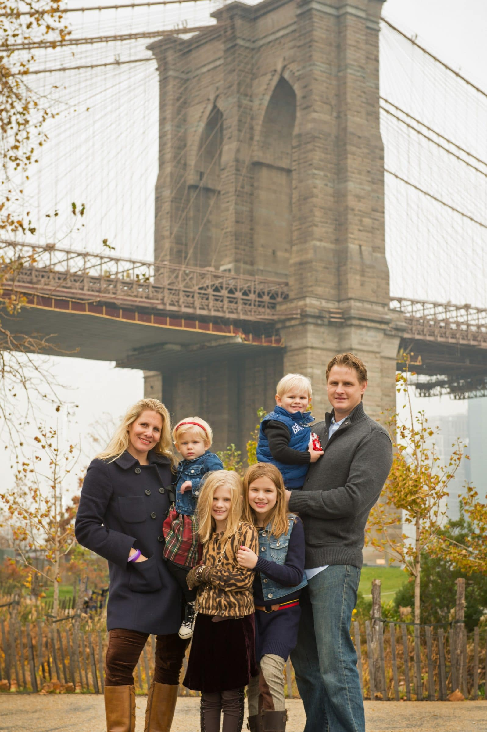family in Brooklyn with Brooklyn Bridge behind them