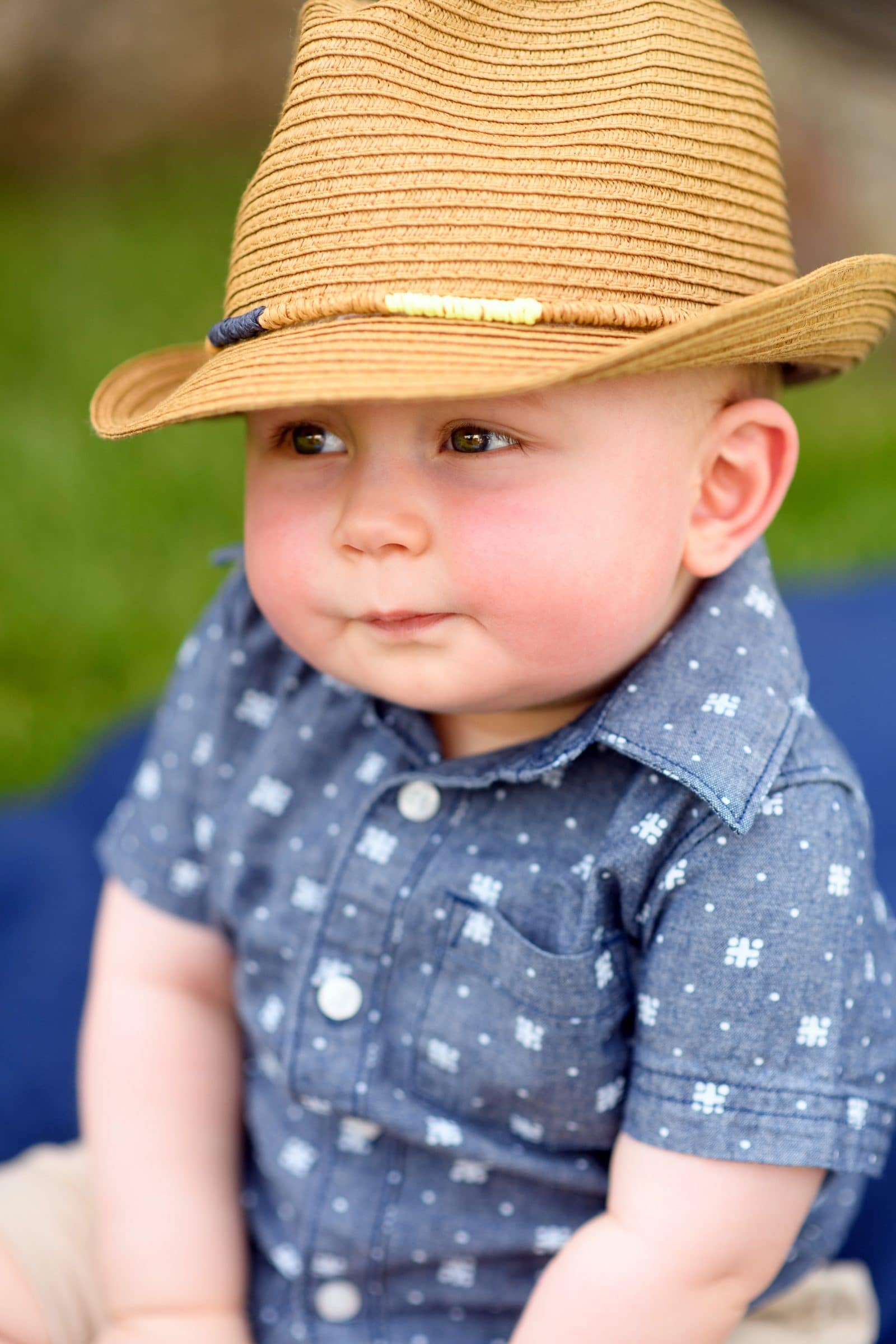 small baby in a cute, stylin hat