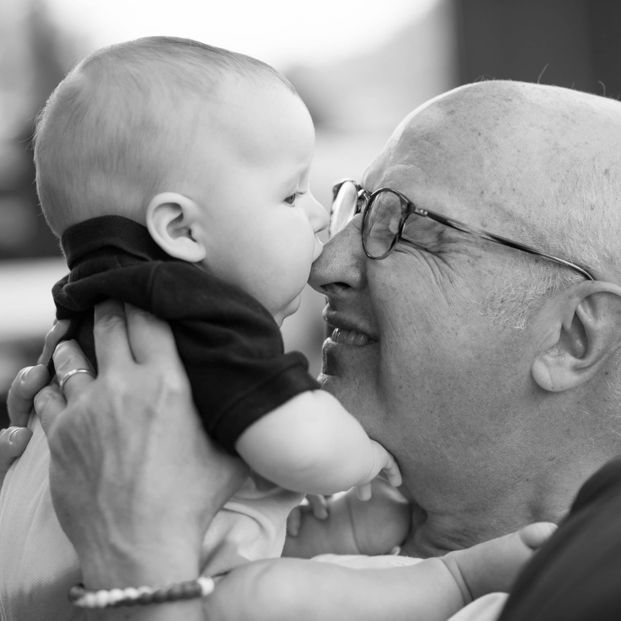 grandpa hugging baby