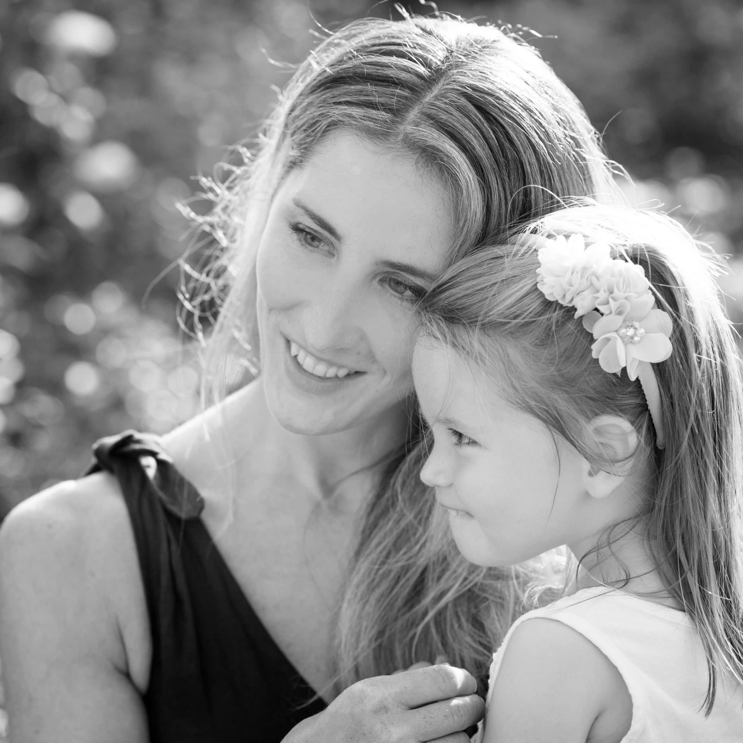 mom embracing daughter