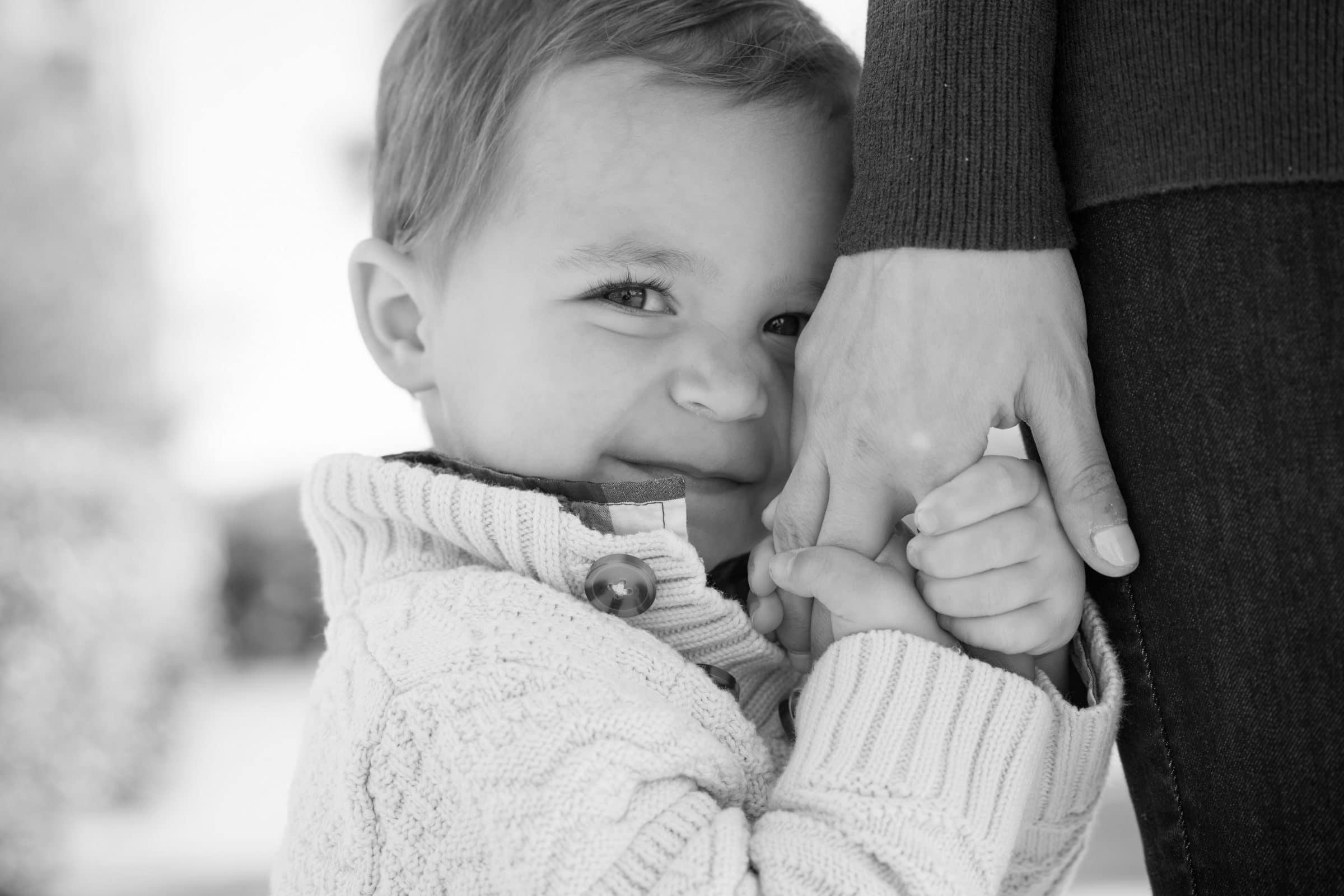 little boy holding dads hand