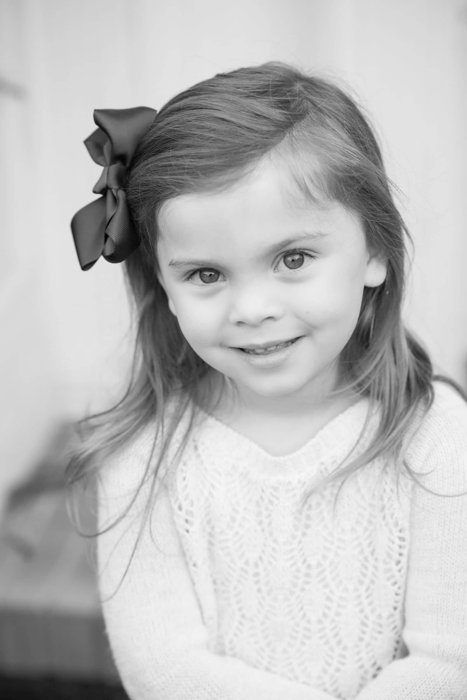 young girl with hair bow