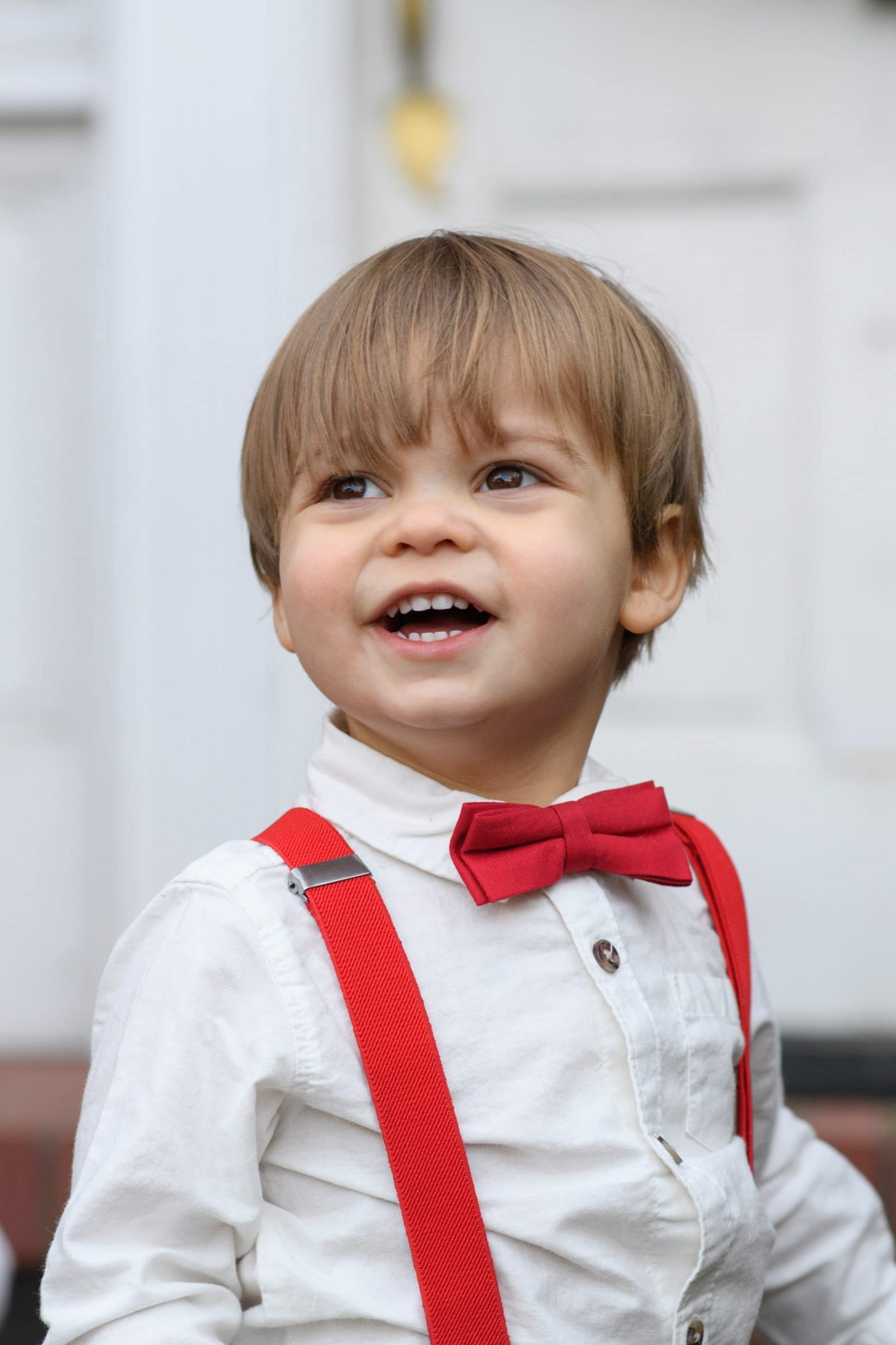small boy in red bow tie