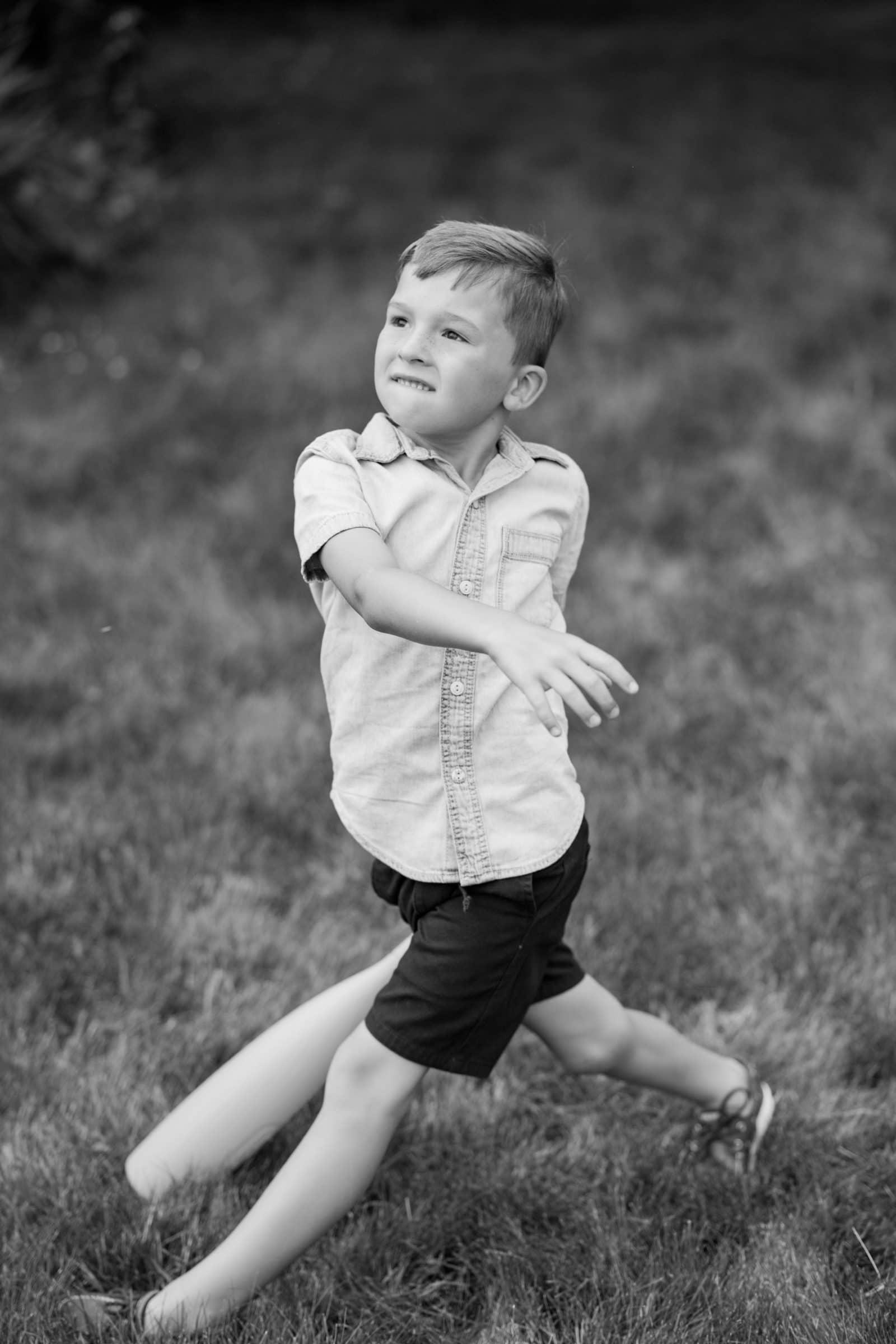 small boy with baseball bat
